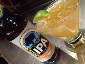 Bottle of IPA next to beer cocktail, Cervecerita