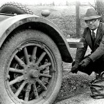 Man changing tire old school