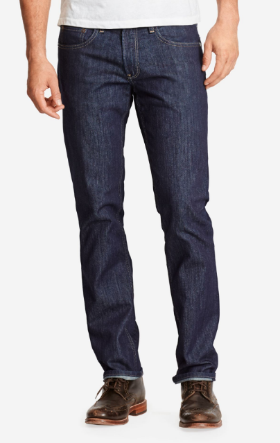 man with dark wash denim and wingtips