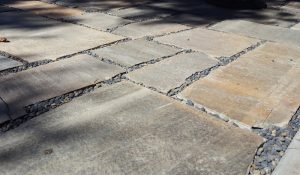 flagstone pavers with blue river pebbles