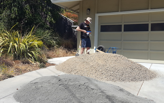 piles of gravel and sand in my driveway