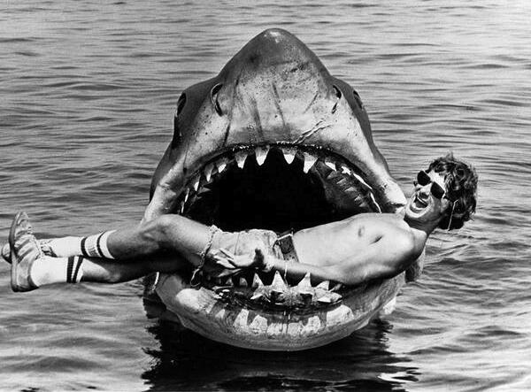 Steven Spielberg playing with robotic shark on jaws set circa 1974