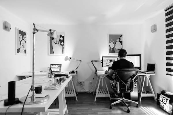 man working in his home office and being productive