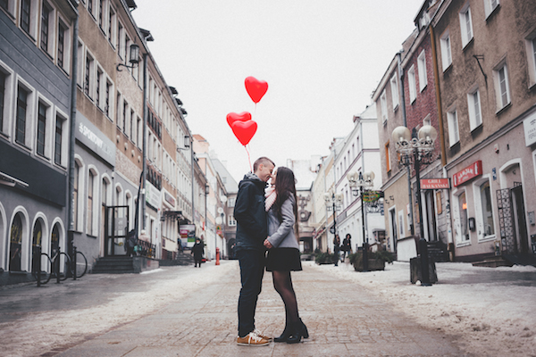 couple kissing in the street on valentines day