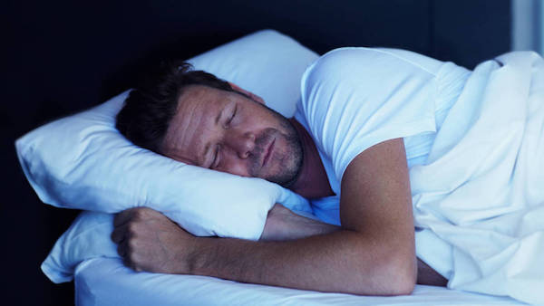 man getting full night's sleep