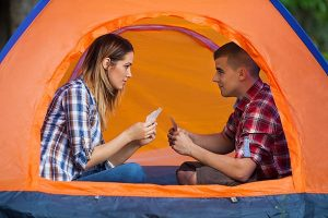 Couple Playing Cards in Tent