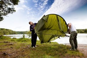 Couple setting up a tent