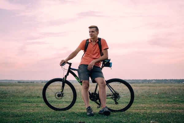 man riding bike in field