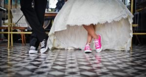 man and woman getting married in converse