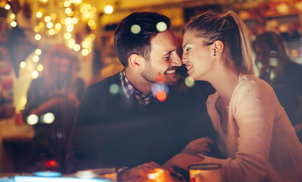 man and woman kissing on a first date