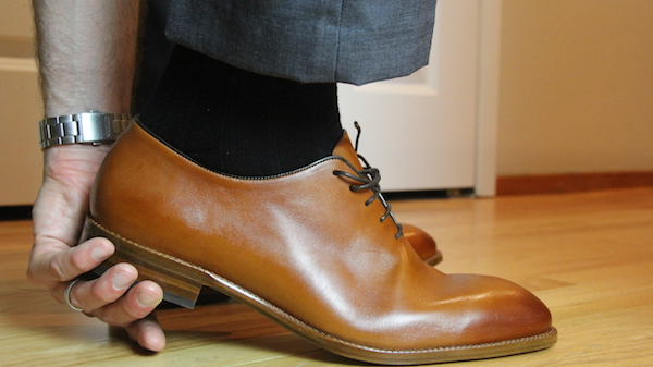 removing shoe by holding heel