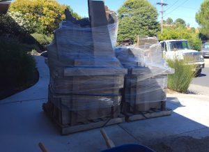 2 large pallets of flagstone in my driveway