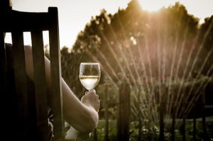 sitting outside drinking wine on your staycation
